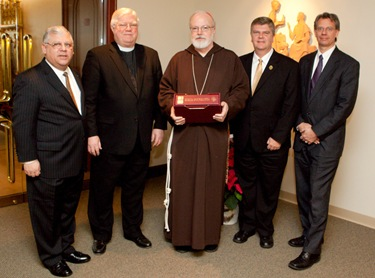 Presentation of the polyglot bible to Cardinal Seán P. O'Malley by representatives of the American Bible Society in the chapel of the Archdiocese of Boston's Pastoral Center Jan. 13, 2009.<br /> Pilot photo/ Gregory L. Tracy