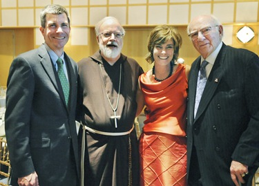 From left, Jeffrey Kaneb, chair of the Board of Trustees of Catholic Charites, Cardinal Sean P. O'Malley, Tiziana Dearing, president of Catholic Charities and A. Raymond Tye, president of The Ray Tye Medical Aid Foundation and Chairman Emeritus of United Liquors Ltd., pose following a Catholic Charities Spring Celebration 2009 at the John F. Kennedy Presidential Library and Museum, Thursday, May 21, 2009 in Boston. Tye was awarded the 2009 Justice and Compassion Award. (Photo/Lisa Poole)