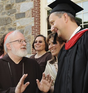 Cardinal Sean P. O'Malley speaks to graduate Andreas Widmer following commencement of Master of Arts in Ministry at St. John's Chapel at St. John's Seminary, Wednesday, May 20, 2009 in Brighton, Mass. (Photo by Lisa Poole)