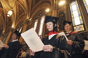 Graduates including Ellen Oesterle, front, and student speaker Andreas Widmer, back right, participate in the commencement of Master of Arts in Ministry at St. John's Chapel at St. John's Seminary, Wednesday, May 20, 2009 in Brighton, Mass. (Photo by Lisa Poole)