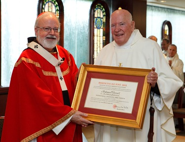 Msgr Andrew Connell receives the decree naming him Apostolic  Protonotary. Photo by Gregory L. Tracy/ The Pilot