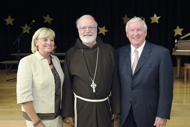 Cardinal Sean P. O'Malley poses with the Connors during an awards night at the Pope John Paul II Catholic Academy in Dorchester, Wednesday, June 2, 2010. (Photo/Lisa Poole)