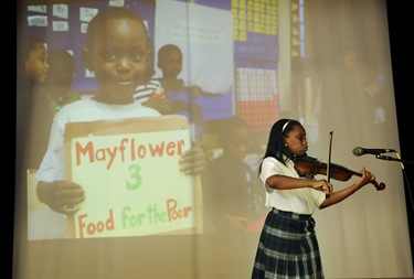 Jeanay Pierre, 10, of Randolph, MA, plays the violin during awards night at the Pope John Paul II Catholic Academy in Dorchester, Wednesday, June 2, 2010. She is a student of the Mattapan campus. (Photo/Lisa Poole)