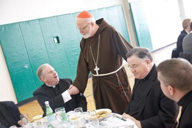 Priests gather for the annual Chrism Mass luncheon at Cathedral High following the Mass.  Fathers James Rafferty and Louis Palmieri were recognized for their service during the lunch. Pilot photo by Gregory L. Tracy