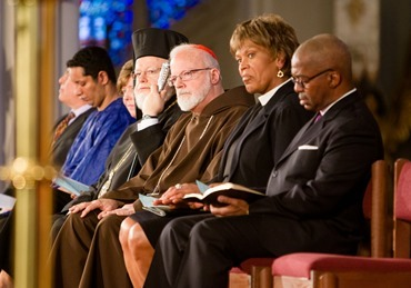 "Boston Cardinal Sean P. O'Malley joins Boston faith leaders at the ""Healing Our City"" interfaith prayer service to honor those affected by the Boston Marathon bombings, held at the Cathedral of the Holy Cross in Boston April 18.<br /><br /><br /><br /><br /> Pilot photo/ Gregory L. Tracy<br /><br /><br /><br /><br />"
