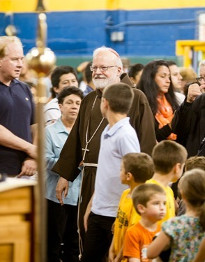 Cardinal Sean O'Malley meets with membersof the Neocatechumenal Way at Immaculate Conception School in Revere June 17, 2013. Photo by Gregory L. Tracy