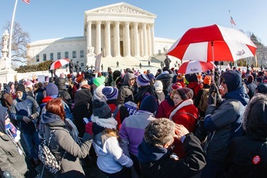 Boston pilgrims stand outside of the Supreme Court during the March for Life Jan. 22, 2014.  (Pilot photo by Gregory L. Tracy)