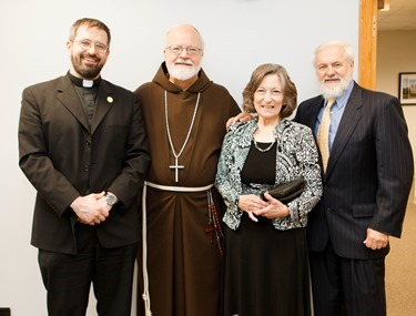 Cardinal Sean P. O'Malley hosts a luncheon for the newly ordained priests of the archdiocese and their families, May 28, 2014 at the Archdiocese of Boston's Pastoral Center. (Pilot photo by Gregory L. Tracy)