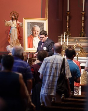 Hundreds of Catholic faithful came to venerate the relic of Pope St. John Paul II at the Cathedral of the Holy Cross June 22, 2014.  The relic was at the cathedral June 21 and 22 as the first stop on a national tour being sponsored by St. John Paul II National Shrine in Washington, D.C. and the Knights of Columbus. (Pilot photo by Gregory L. Tracy)