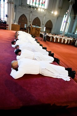 Cardinal Seán P. O'Malley ordains 13 men as permanent deacons at the Cathedral of the Holy Cross Sept. 20, 2014. The newly ordained are: Deacons Francis X. Burke, Michael F. Curren, William A. Dwyer, George C. Escotto, Edward S. Giordano, Charles A. Hall, Franklin A. Mejia, Eric T. Peabody, Jesús M. Pena, Álvaro José L. Soares, Michael P. Tompkins, Jude Tam V. Tran, and Carlos S. Valentin. Pilot photo/ Gregory L. Tracy
