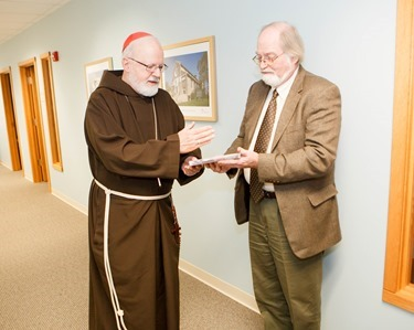 Cardinal Sean P. O'Malley is pictured with retiring archivist of the Archdiocese of Boston, Robert Johnson-Lally in the cardinal's offices, Jan. 7, 2015. Johnson-Lally retired Dec. 31, 2014 after serving the archdiocese from more than 20 years. Pilot photo/ Gregory L. Tracy