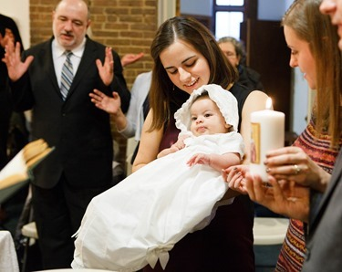 Baptism of Olivia Isabel Enrique at Our Lady of the Assumption Parish, East Boston, Jan. 4, 2015. Photo by Gregory L. Tracy