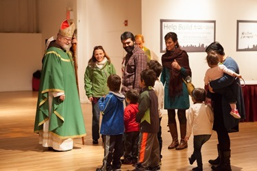 Sean Cardinal O'Malley greeting a family at New York Encounter 2015 before the celebration of mass.