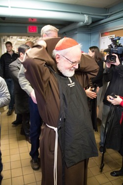 Cardinal Seán P. O'Malley visits Pine Street Inn homeless shelter in Boston Dec. 24, 2104. Pilot photo/ Christopher S. Pineo