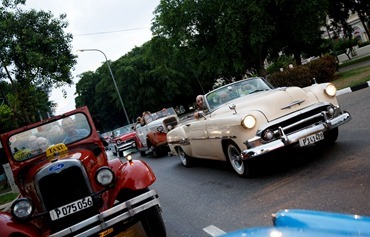 The pilgrims received a treat of picked up for their Sept. 21 farewell dinner in Havana's famous classic car taxis. Pilot photo/ Gregory L.  Tracy