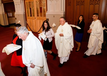 Ordination Mass of Permanent Deacons Timothy Booker, Paul Carroll, Nicolas Cruz, Joseph Dorlus, James Kearney, Kelley McCormick, Jonathan Mosley, John Murray, Charles Rossignol, Jose Torres, Roger Vierra, and Thomas Walsh Jr., at the Cathedral of the Holy Cross Oct. 17, 2015. Pilot photo/ Gregory L. Tracy
