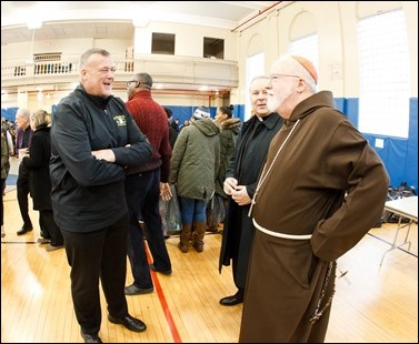 Cardinal O'Malley visits the Teen Center and St. Peter's in Dorchester Saturday, Dec. 24, 2016. In partnership with the Menino family, Catholic Charities of Boston distributed Christmas gifts to nearly 400 children and families in need. Pilot photo/ Gregory L. Tracy