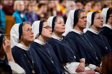 Religious women listen as New York Cardinal Timothy Dolan delivers his homily at Vigil Mass for Life, held Jan. 26 at the Basilica of the National Shrine of the Immaculate Conception in Washington, D.C. Pilot photo/ Gregory L. Tracy