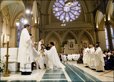 Ordination to the priesthood of Fathers Jason Giombetti, Pablo Gomis, Kevin Leaver, Godfrey Musabe, Wellington Oliveira, Joel Americo Santos, William Sexton, Michael Zimmerman, celebrated by Cardinal Seán P. O'Malley at Immaculate Conception Church in Lowell, May 20, 2017. Pilot photo/ Gregory L. Tracy