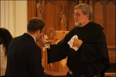 Adopt_08_Father Peter G. Gori presents the congregation the relic before blessing
