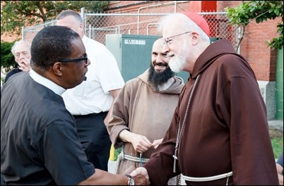 Cardinal O'Malley, priests and other religious leaders participate in a walk for peace in Dorchester, July 11, 2017. Pilot photo/ Mark Labbe
