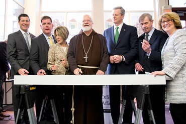 The Planning Office for Urban Affairs and St. Francis House brakes ground Jan. 16, 2018 on The Union, an affordable housing redevelopment located at 48 Boylston St. in downtown Boston. Cardinal Sean P. O'Malley, Gov. Charlie Baker, Mayor Martin J. Walsh, Planning Office for Urban Affairs President Lisa Alberghini, and President and CEO of St. Francis House Karen LaFrazia, were joined by leaders from business, government and the private sector at the ground breaking. Participants signed a beam that will be used the construction of the new facility.<br /> Pilot photo/ Mark Labbe