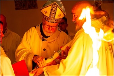 Cardinal O'Malley celebrates the Easter Vigil with the blessing of the Easter fire and the reception of new members of the Church at the Cathedral of the Holy Cross, March 31, 2018. Pilot photo/ Mark Labbe