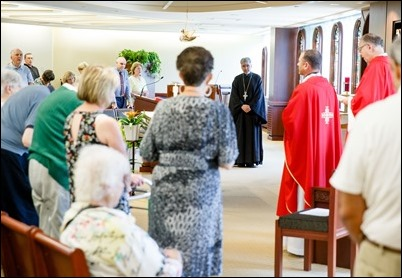 Father Demetri Tonias, representative of the Greek Orthodox Metropolitan of Boston, attends the Mass celebrated by Father Daniel Hennessey on the Feast of the Sts. Peter and Paul at the Archdiocese of Boston's Pastoral Center in Braintree, June 29, 2018. For almost 30 years the Catholic and Greek Orthodox communities of Boston have followed the practice of exchanging delegations on the feast days of their patron saints. Pilot photo/ Gregory L. Tracy