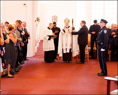 Cardinal Sean P. O'Malley celebrates the Rite of Reception for fallen Weymouth Police officer Sgt. Michael Chesna at St. Mary Church in Hanover, July 19, 2018. Photo by Gregory L. Tracy, The Pilot