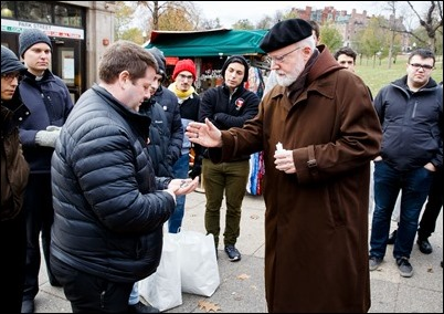 Cardinal O'Malley gives his blessing to seminarians from St. John Seminary as they prepare to distribute food and Miraculous Medals to the homeless and needy on BostonCommon as part of the Fratello initiative, marking World Day of the Poor, Nov. 18, 2018. Pilot photo/ Gregory L. Tracy