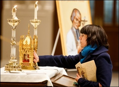 The relic of the incorrupt heart of the St. John Vianney is venerated at the Cathedral of the Holy Cross April 30, 2019.  The period of veneration included a 7 p.m. Mass celebrated by the archdiocese's vicar general, Bishop Peter Uglietto. Pilot photo/ Gregory L. Tracy
