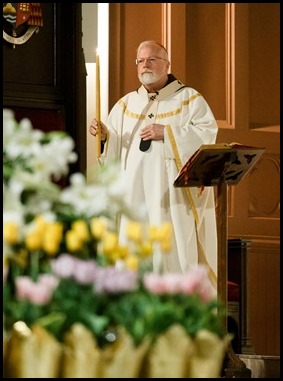 Cardinal Sean P. O'Malley celebrates the Easter Vigil at the Cathedral of the Holy Cross, April 12, 2020. Pilot photo/ Gregory L. Tracy