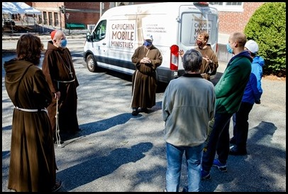 Cardinal Sean O'Malley blesses the van used by Capuchin Mobile Ministries' outreach to the homeless at San Lorenzo Friary in Jamaica Plain March 27, 2021. Pilot photo/ Gregory L. Tracy