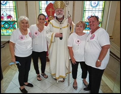 St. Lucy Society members with the Cardinal